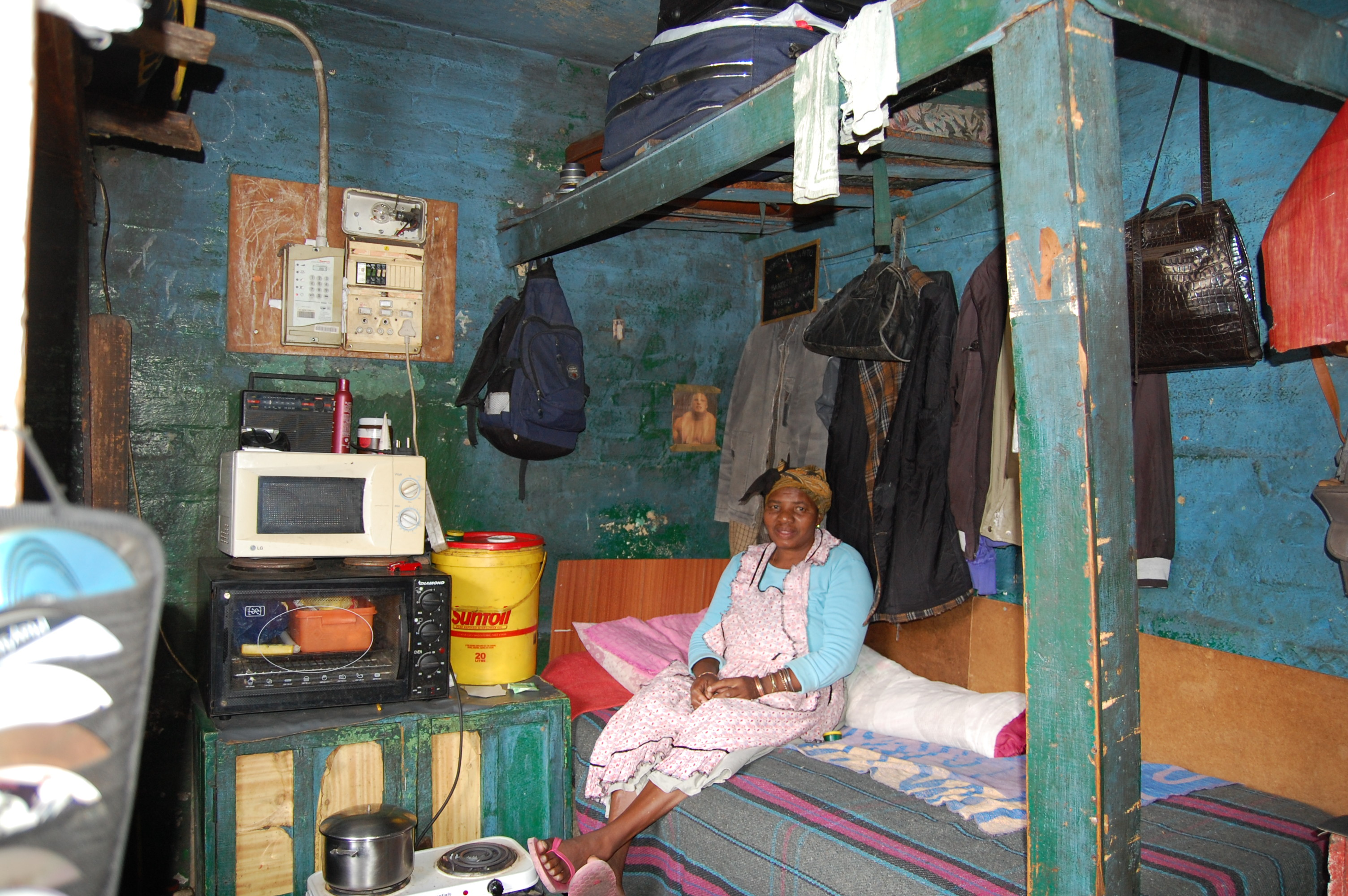 One of three beds in a bedroom in a township. One bed is meant for one family of six people. Three people sleep on this bed, the man, his wife and the youngest child. The other children sleep on the floor of the bedroom and the common room.