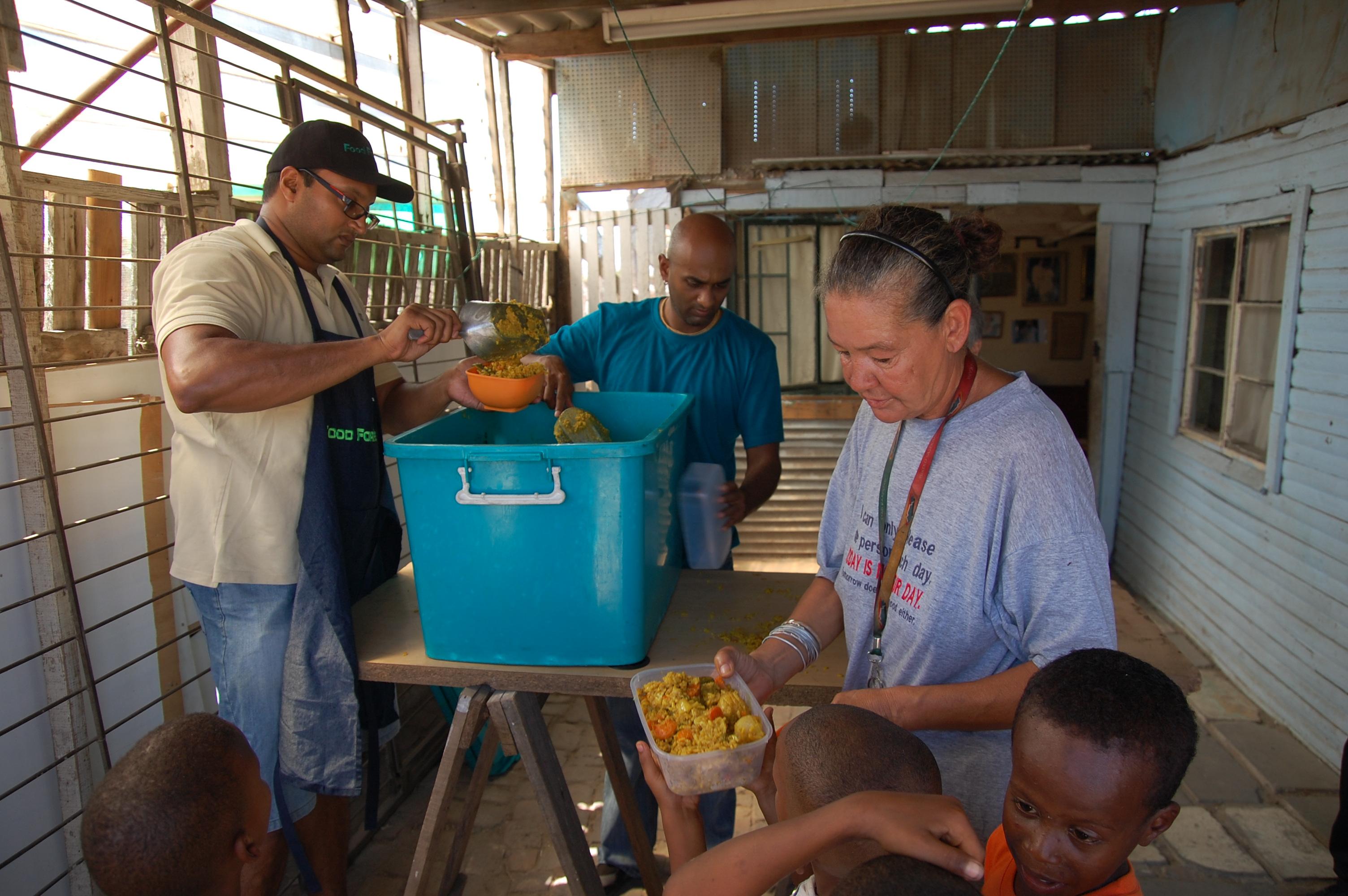 In Overcome Heights. Volunteers serving food