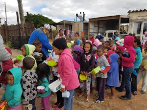 In Grabouw. Recipients line up to receive dishings