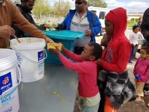 In Grabouw. A child receiving food