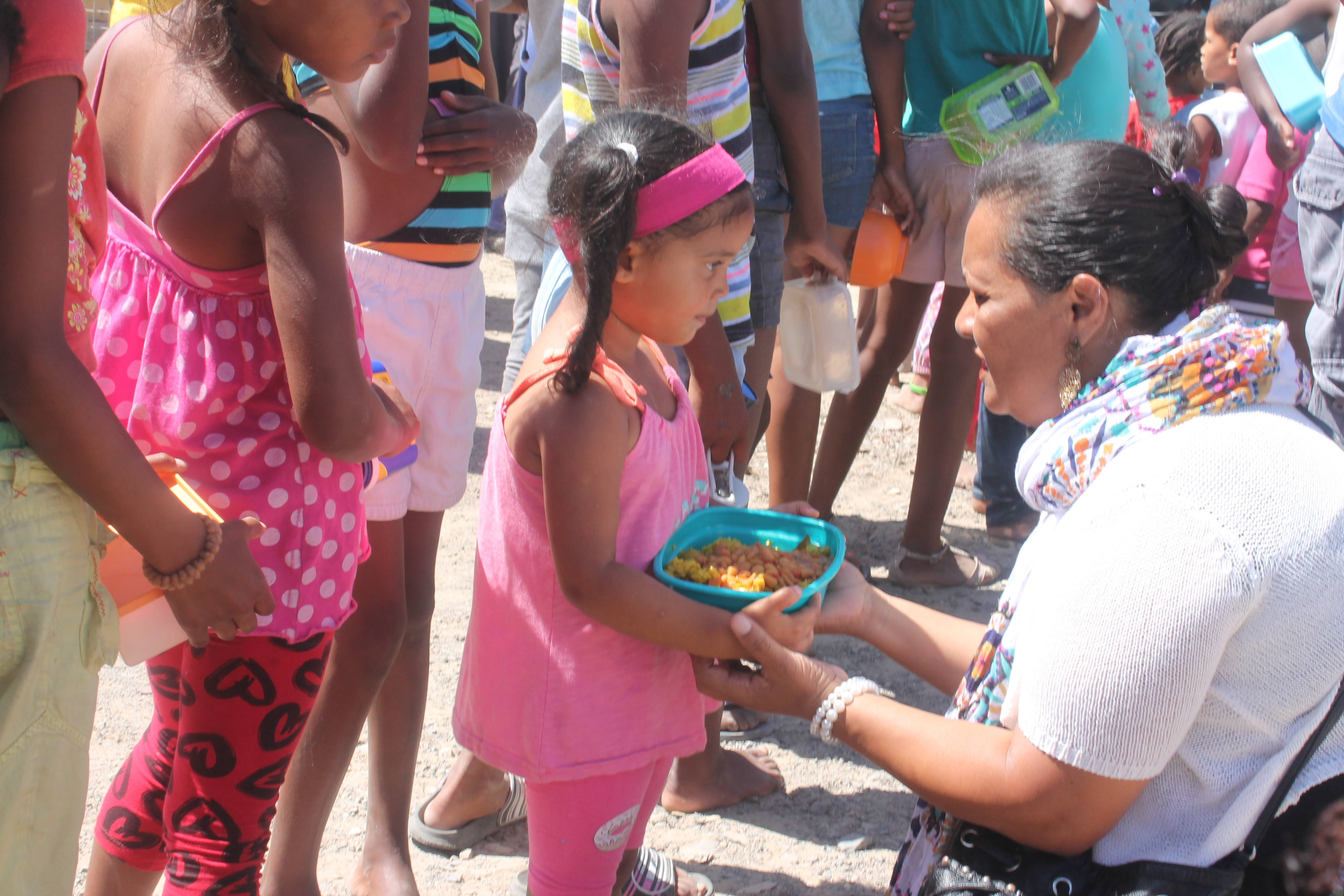In Overcome Heights. A child receiving food from our community anchor Mymoena